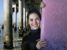 BACK FOR MORE: Devyn Bisson, 15, of Huntington Beach, is photographed underneath the Huntington Beach Pier before surfing for the first time since being hit in the head by a surfboard last August.