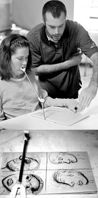 Top: Rebecca Wylie works on a drawing in an art class as instructor Curtis Erlinger critiques her work in March. Wylie, a graphic design major, developed a post-viral infection that left her paralyzed as a child. Bottom: Wylie's mouth pointer rests on four facial drawings that she completed in class.