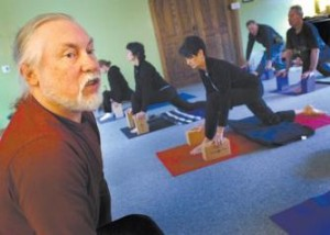 Ed Scheterlak, Jenny McCune's husband, teaches a free class at the Bozeman Yoga Center Tuesday morning during Community Celebration Week to acknowledge the people who have helped him and McCune after she suffered a life-altering bicycle accident in July.