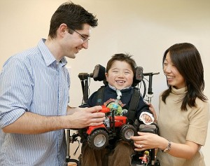 Dedicated family: Neil and Kazumi with their son Sam