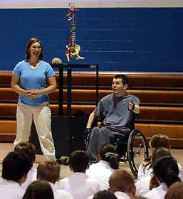 Eric Wildt discusses the spine and his injuries during a visit with students at St. Ignatius School in Monfort Heights.