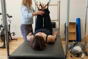 Potts performs rehab with her physical therapist, Pam Seidler. (Diane Moore, Special to The Denver Post)