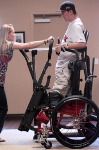 Caregiver Cherie Fisk, 25, assists Hal Hargrove Jr., 19, of Claremont with a workout while Hargrove is on a standing frame at The Claremont Club. Hargrove was paralyzed in a car accident two years ago. He started the Be Perfect Foundation, which is hosting its second annual fundraiser Saturday. (Thomas R. Cordova / Staff Photographer)