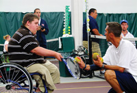 Dan James, coach of the U.S. Paralympic tennis team, teaches a local youth the fundamentals of wheelchair tennis. Derrick Knutson/Review