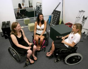 Dana Guest (left) of Dade City, Amanda Perla of Maitland and Donna Marini of Altamonte Springs chat recently at Step It Up Recovery Center in Sanford. (JOE BURBANK, ORLANDO SENTINEL / May 16, 2009)