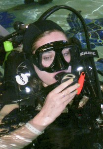 """GOING DOWN: While at Craig Hospital, Aubrey tried several new things such as scuba diving at a downtown center where she stayed underwater for 45 minutes. """"I loved it,"""" Aubrey said."""