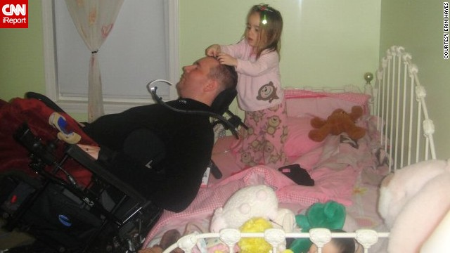 """Izzy puts clips in her dad's hair in 2010. """"They love being silly together and for all his big talk about being in charge and her listening to him, he'll do whatever she wants,"""" Hayes said."""