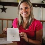 Alissa Boyle shows her wedding invitation