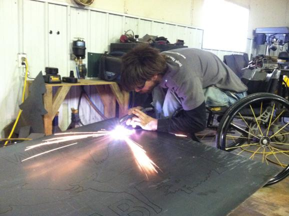 Chris Hrabik works on a piece of metal in his shop in Sedgewickville, Mo. About 90% of his metal artwork is custom made.