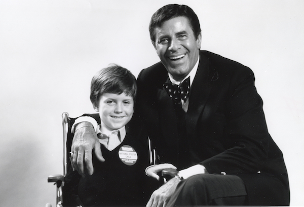 Christopher Rush and Jerry Lewis, circa 1983 (Photo credit: Muscular Dystrophy Association )