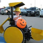 Caleb McLelland at age 3, all smiles as he gets ready to scoop up some Halloween candy in his sweet ride.