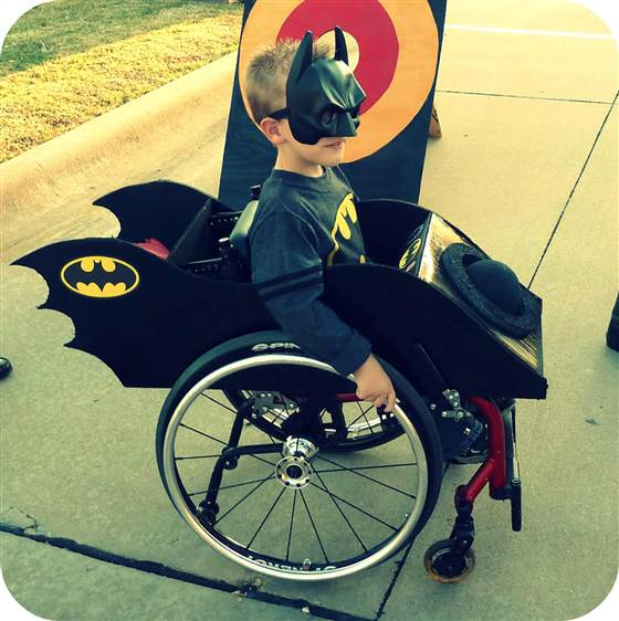 I am... the Batman! For Caleb McClellan and other children who use wheelchairs, Halloween offers the chance to dress up just like any other kid.