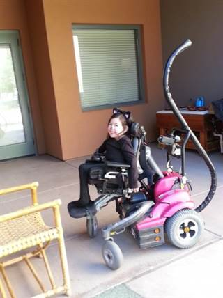 Not your basic cat: For her costume last year, Lauren's parents affixed her six-foot-long cat tail to the charging port on the back of her wheelchair.