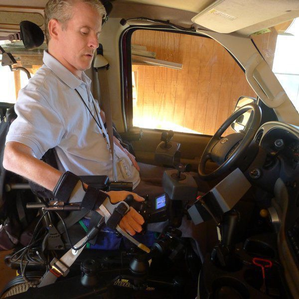 Evan Edwards in his MDRS-modified van. The van has two joysticks for steering and accelerating and takes voice commands.