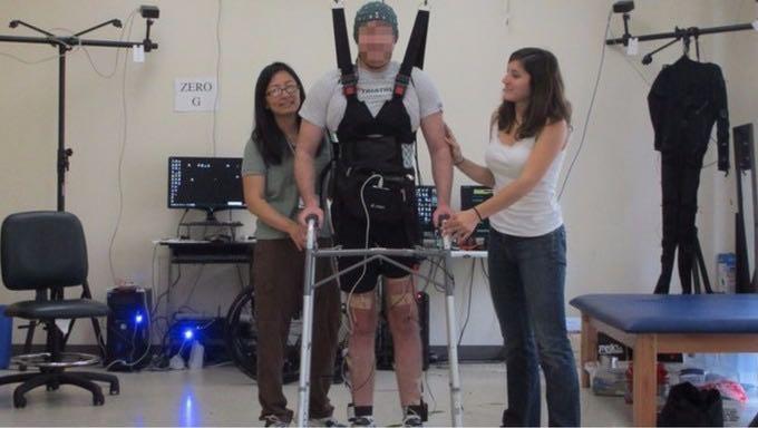Adam Fritz walks after his surgery.