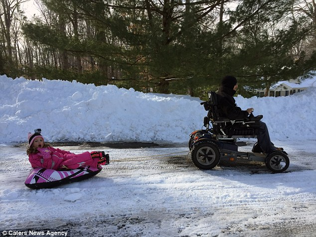 Elaina enjoys a sledge ride with her dad. Glen wants to show other disabled parents that nothing is impossible