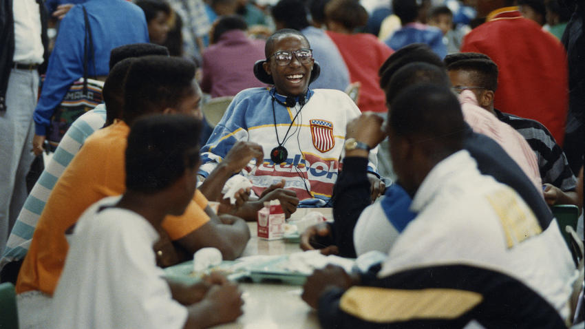 """Kenneth Jennings laughs with friends in the lunchroom at Simeon High School in June 1989. In his mind, Jennings says, """"I'm just an average guy."""" (Chris Walker / Chicago Tribune)"""