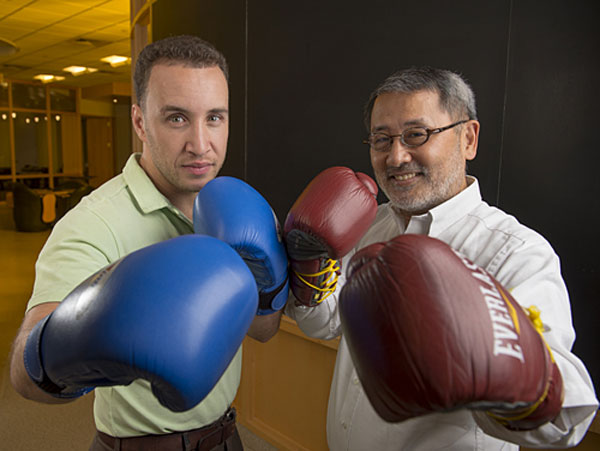 Professional boxer Boyd Melson and Rutgers neuroscience professor Wise Young want to knock out spinal cord injury and believe a cure is possible. Photo by and credit to Nick Romanenko, Rutgers University Photographer.