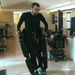 Mitch Brogan walking with exoskeleton