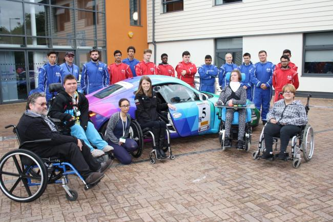 Nathalie McGloin with Barnet & Southgate College LLDD and motorsport students
