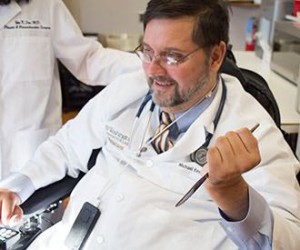 Nerve-transfer surgery restored physician Michael Bavlsik's ability to grip utensils, pens, medical tools and other items with his left hand.