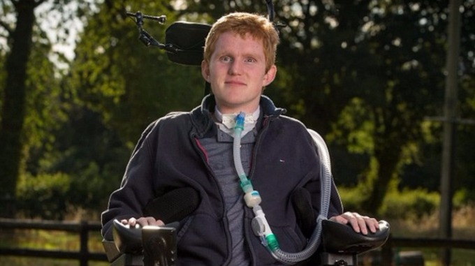 Rob Camm, 21, was paralysed in a car crash two years ago. Credit: SWNS