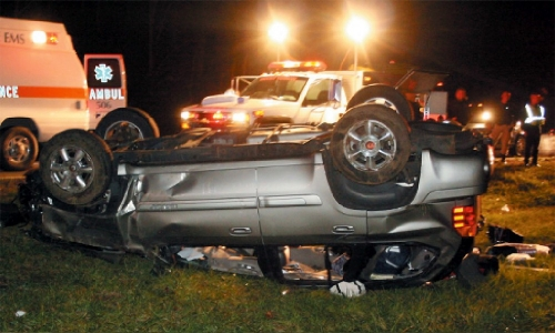 Ryan Atkins' SUV flipped several times before coming to rest on its roof after hitting a guard rail on Nov. 20, 2009. Three of the vehicle's five passengers were ejected from the SUV. Photo/Mount Vernon Signal
