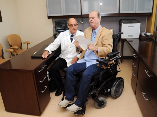 St. Cloud native Steve Klemz (right) consults with Dr. Steven Scott, D.O., chief of Physical Medicine and Rehabilitation at the James A. Haley Veterans Hospital in Tampa, Florida (Photo: Photo courtesy of James A. Haley Veterans Hospital )