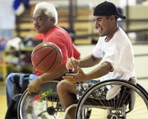 JAMM AQUINO / JAQUINO@STARBULLETIN.COM Kekoa Cuban, right, goes for a loose ball as Jeff Sampaga eyes a steal at the Manoa District Park gym, where members of Wheelchair Sports Hawaii gather every week to play hoops.