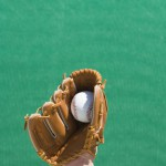 Hand with glove catching baseball
