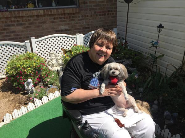 Champion quadriplegic Becky Reeve holds her pal, Meeka. (Lee Benson)
