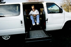 Bill Iverson is elevated into his van. In 2001 he created the Spinal Cord Injury Network, which has helped nearly 50 people from Napa and Sonoma. Lianne Milton/Register
