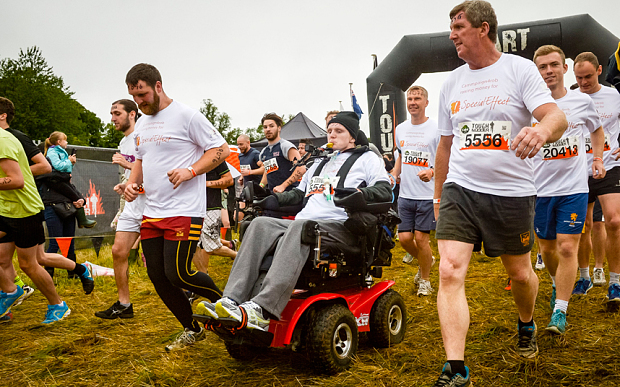 Rob Camm sets off with his teamates as he becomes the first quadriplegic to take part in a Tough Mudder event Photo: PA