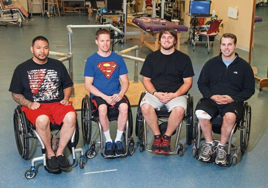 Left to right is Andrew Meas, Dustin Shillcox, Kent Stephenson and Rob Summers, the first four to undergo task-specific training with epidural stimulation at the Human Locomotion Research Center laboratory, Frazier Rehab Institute, as part of the University of Louisville's Kentucky Spinal Cord Injury Research Center, Louisville Kentucky.(Photo: Photo Courtesy of the University of Louisville)