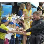 Rick Hansen greets students at Cardigan elementary