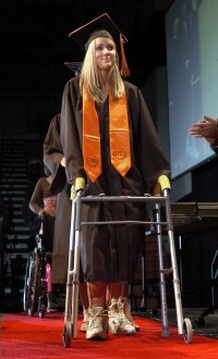 Customized leg braces, a walker and help from a friend allow Kadi to walk across a stage to receive her high school diploma. She heads to NeuroVita Clinic in Russia a few days after graduation for her first stem cell treatment.