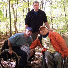 Eric Larson (center) with Patrick Maher (left) and George Alfaro at Mississippi Palisades State Park, Savanna, during a Moving Mountains program. Larson, a former Putnam resident, is the chief operating officer of the National Spinal Cord Injury Association. Submitted photo